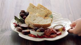 Португальская закуска на белом блюде видеоматериал