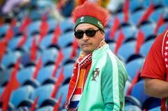 ПОРТУ, PORTUGLAL - 9-ое июня 2019: Португальские вентиляторы и зрители в стойках поддерживают команду во время лиги наций UEFA стоковое фото rf