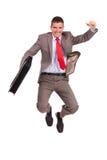 Портфель и скакать удерживания бизнесмена Стоковое Изображение RF