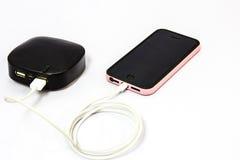 Поручая мобильный телефон Стоковое Фото