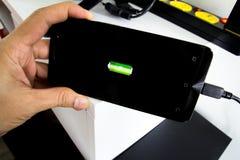 Поручите Smartphone телефона стоковые фото