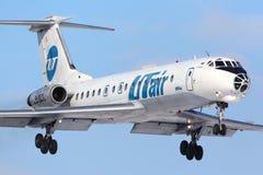 Посадка Туполева Tu-134 Utair на международном аэропорте Vnukovo Стоковые Фото