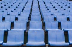Посадочные места стадиона голубого цвета пластичные Стоковое Изображение