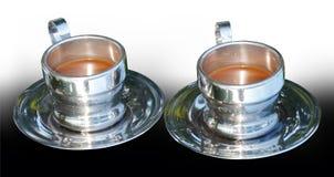 2 посеребренных чашки кофе на предпосылке градиента Стоковая Фотография RF