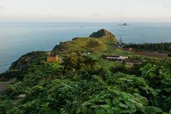 Последний свет на утесе головы дракона на побережье Yongmeori, Sanbang-ro, острове Jeju, Южной Корее Стоковая Фотография RF