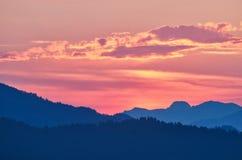 Послесвечение захода солнца, отражения на облаках, Греции Стоковая Фотография