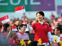 Послужите флаг Fu фиоритуры развевая во время NDP 2012 Стоковое Изображение RF