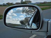 Посмотрите в зеркале заднего вида Стоковая Фотография