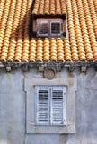 Посмотрите старое окно и малый dormer Стоковые Фото