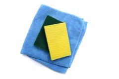 поставкы губок ткани чистки предпосылки новые померанцовые Стоковые Изображения RF