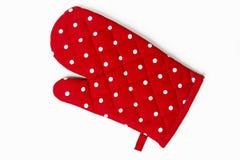 Поставленная точки красным цветом перчатка кухни Стоковое Изображение RF
