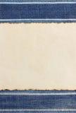 Постаретая бумага на джинсах Стоковые Фото