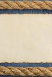 Постаретая бумага на джинсах Стоковая Фотография