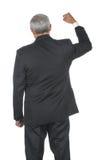 постаретая середина руки бизнесмена подняла стоковые изображения