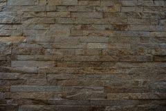 Постаретая стена плитки кирпича утеса каменная Стоковая Фотография RF