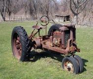 постаретый трактор Стоковая Фотография