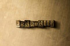 ПОСТЕПЕННО - конец-вверх grungy года сбора винограда typeset слово на фоне металла стоковое фото rf