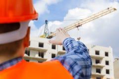 Построитель управляет строительной площадкой Стоковое Изображение RF