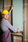 Построитель в новой квартире стоковое изображение