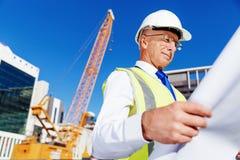 Построитель инженера на строительной площадке Стоковые Фото