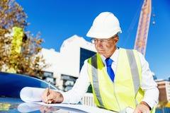 Построитель инженера на строительной площадке Стоковое Фото