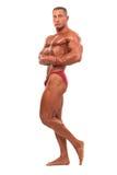 Построитель мужского тела демонстрируя изолированное представление, стоковое изображение
