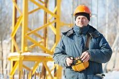 Построитель с оборудованием дистанционного управления крана башни Стоковая Фотография RF