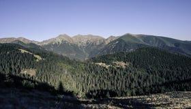 Последние лучи касаются высоким горам в осени Стоковое Изображение