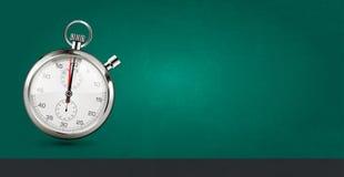 Последняя мельчайшая концепция - секундомер на зеленой предпосылке Стоковое Изображение