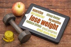 Потеряйте вес - подсказки на таблетке стоковое фото