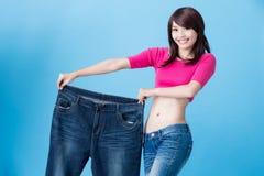 Потеря веса выставки женщины стоковое изображение rf