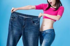 Потеря веса выставки женщины стоковое фото rf