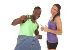 Потеря веса женщины брюк человека большая Стоковые Изображения RF