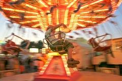 потеха мальчика идет иметь веселый круг Стоковая Фотография RF