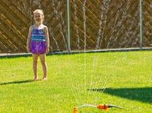 Потеха сада с спринклером Стоковые Фото