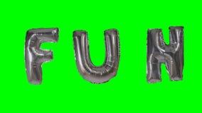 Потеха слова от писем воздушного шара гелия серебряных плавая на зеленый экран - акции видеоматериалы