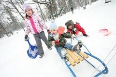 Потеха снега зимы детей Стоковые Изображения RF
