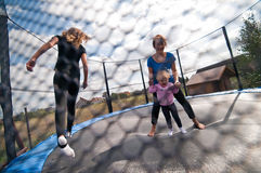 Потеха trampoline семьи Стоковое Изображение RF