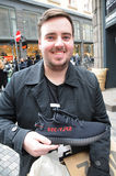 Потребитель с моделью SPLY-320 ботинка Kenny западной Стоковое Изображение