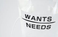 потребности хотят Стоковое Фото