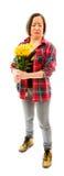 Потревоженная молодая женщина держа букет солнцецветов Стоковое фото RF