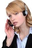 Потревоженный работник центра телефонного обслуживания стоковые изображения