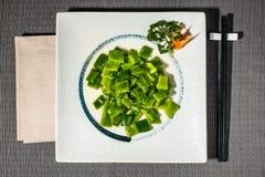 Потушенные галки закалённые с семенами масла и сезама Стоковые Изображения