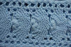 похожая на Вентилятор картина на небесно-голубой связанной ткани Стоковые Изображения