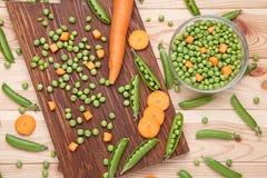 похожие моркови шара закрывают вещи горохов метафоры еды здоровые совместно Стоковая Фотография