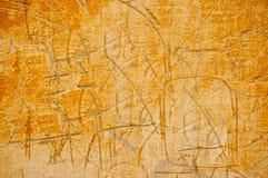 Поцарапанная стена цемента покрашенная в апельсине Стоковые Изображения RF