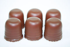 Поцелуй шоколада на белой предпосылке Стоковые Изображения