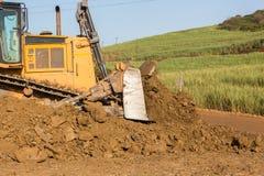 Почва ведра машины движенца земли конструкции Стоковые Изображения RF