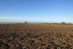 Почва плужка в январь Стоковая Фотография RF