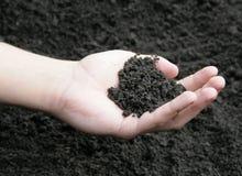 почва руки Стоковые Фото
